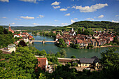 """View over the Rhine river towards the """"double"""" town of Laufenburg, which is connected by a bridge across the Rhine river; left: Laufenburg, High Rhine, Black Forest, Baden-Württemberg, Germany; middle and right: Laufenburg, High Rhine, Canton Aargau, Swit"""