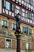 Facades and figure on a fountain at the city hall square, Stein am Rhein, High Rhine, Lake Constance, Canton Schaffhausen, Switzerland, Europe