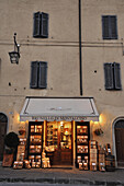 View at illuminated wine shop at Montalcino, southern Tuscany, Italy, Europe