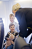 Passengers and stewardess in an airplane, Munich airport, Bavaria, Germany