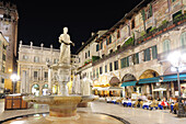 lluminated square, Piazza delle Erbe at night, UNESCO World Heritage Site, Verona, Venetia, Italy