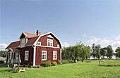 Countryside with red wooden cottage, Smaland, Sweden, Europe