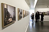 People at photo exhibition with photographs of Guy Tillim Avenue Patrice Lumumba, Fondation Henri Cartier-Bresson, Paris, France, Europe