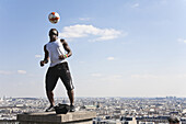 Street artist with football at Montmartre, Paris, France, Europe