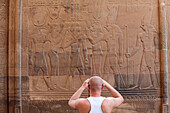 Tourist taking a photograph in front of the Temple of Kom Ombo, Egypt, Africa