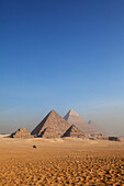 Pyramids of the Queens in the front and the pyramids of Menkaure, Khafre and Khufu (from left), Giza, Cairo, Egypt, Africa