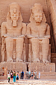 Tourists in front of the giant statues at the Temple of Rameses II., Abu Simbel, Egypt, Africa