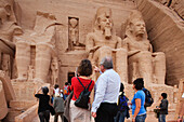 Tourists in front of giant statues at Temple of Rameses II., Abu Simbel, Egypt, Africa