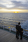 Young couple looking sunset from deck of Cruiseship MS Deutschland (Deilmann Cruises), South Atlantic Ocean, South America, America