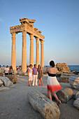 Tourists take photos in Temple of Appollon and Athena in Side, south coast, Anatolia, Turkey