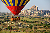 People in the basket ballooning in the valley of Göreme, Cappadocia, Anatolia, Turkey
