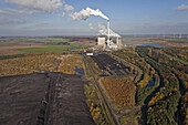 Aerial view of a lignite open-pit mine at  fossil-fuel power station Buschhaus, cooling towers in the background, Helmstedt, Lower Saxony, northern Germany