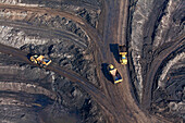 Aerial view of an open-pit lignite mine, Lorries transporting brown coal, Schöningen, Lower Saxony, Germany