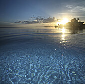 The infinity pool of a hotel at sunset, Baclayon, Bohol, Philippines, Asia