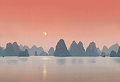 Coastline with limestone formation in the afterglow, Halong Bay, Vietnam, Indochina, Asia