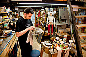 Man building a puppet, Ortigia, Syracuse, Sicily, Italy