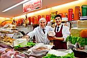 Sales people at delicatessen, Marsala, Sicily, Italy