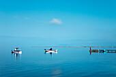 Boats in calm sea, Marsala, Sicily, Italy