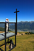 Man with binoculars admiring the view from the chapel Santa Maria degli Angeli, (Architect: Mario Botta), Alpe Foppa, mountain hike to Monte Tamaro, Ticino, Switzerland