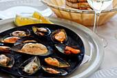 Steamed mussels in a restaurant in Funchal, Madeira, Portugal