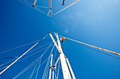 Low angle view at a sailor at the mast of a sailing boat, Croatia, Europe