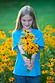 girl with bouquet of black eyed susans