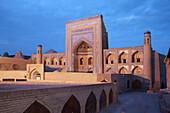 Alloquli Khan Medressa at early evening, Khiva, Uzbekistan, Central Asia