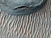 The Red Planet is home to Valles Marineris, the solar system´s largest canyon  Within this canyon lies Ius Chasma  This image, which spans the floor of its southern trench,m was taken by the Mars Reconnaissance Orbiter  The canyon is well-known for its fi
