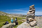 Mountaineers practice mountaineering in the mountains of the Sierra de Gredos National Park  At the end of the image the summit of Almanzor peak  Navacepeda de Tormes  Ávila  Castilla y León  Spain
