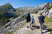 Family practice mountaineering in the Ándara massif, of walking in the Picos de Europa National Park, at bottom the top of La Pica de Mancondiu  Cantabria, Spain