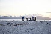 Sunrise on sandy beach, Cousine Island with view to Praslin Island, Seychelles