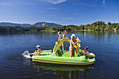 Woman and children in a boat on lake Staffelsee, near Seehausen, Bavaria, Germany