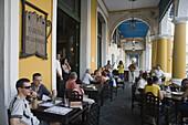 People seated outdoors at Taberna de la Muralla Brewery Bar and Restaurant, Havana, Cuba