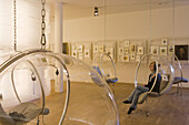 Young woman listens to music in listening pod of Bachhaus Museum, birthplace of Johann Sebastian Bach, Eisenach, Thuringia, Germany, Europe