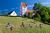 Cyclists passing Isar Cycle Route, near Niederporing, Lower Bavaria, Germany