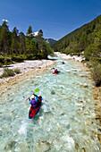Kayaking on upper reaches of Isar river, Hinterau valley, Karwendel range, Tyrol, Austria