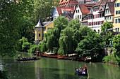 Gondola at Neckar river, water front with Hölderlin tower, Tübingen Neckar, Baden-Württemberg, Germany