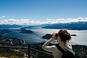 Woman with binoculars in Bariloche, Argentina