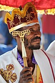 Ethiopia, Lalibela,Timkat festival, Christian orthodox priest   Every year on january 19, Timkat marks the Ethiopian Orthodox celebration of the Epiphany  The festival reenacts the baptism of Jesus in the Jordan River  Wrapped in rich cloth, the church Ta