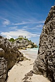 El Castillo The Castle and rocky beach at the Mayan ruins of Tulum in Quintana Roo, Mexico