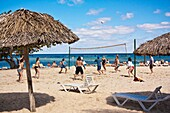 People playing beach volleyball, ball up in the air, Caribbean, Cuban resort