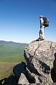 A hiker enjoys the views from the summit of Mount Liberty during the summer months  Located in the White Mountains, New Hampshire USA