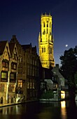 The Belfry tower overlooks canalside houses in the medieval town of Brugge  Belgium