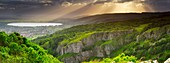 Panoramic view of Cheddar Gorge on the edge of the Mendip Hills in Somerset, England, United Kingdom  The town of Cheddar and Cheddar Reservoir lie at the end of the gorge