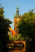 Canals and tower of Saint Catherines church in central Gdansk Poland EU