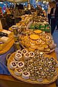Cheese stall at weekend organic market at Placa del Pi in Barri Gotic district in Barcelona Spain Europe