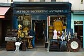 Shop selling decorative antiques along Portobello Road West London England UK