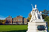 Statue of Queen Victoria in front of Kensington Palace in Kensington Gardens west London England UK