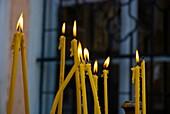 Lit candles outside Sveti Dimitrija orthodox church in Carsija district of Skopje Macedonia Europe