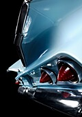 Abstract closeup of iconic car 1960 Chevrolet Impala wings and taillights